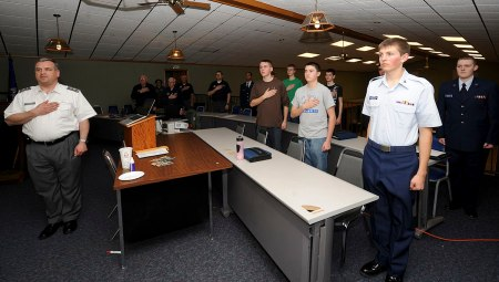 Members of the Civil Air Patrol Rushmore Composite Squadron stand and recite the Pledge of Allegiance during a monthly meeting at Ellsworth Air Force Base, S.D., March 25, 2013. CAP is the official Air Force auxiliary, and a national community service organization made up of trained civilian volunteers. (U.S. Air Force photo by Airman 1st Class Anania Tekurio/Released)