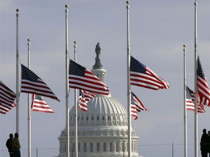 Flags fly at half staff in honor of former President Gerald Ford at the Washington Monument, with the U.S. Capitol in the background, on Dec. 27, 2006. Ford will lie in state in the Capitol before burial in Grand Rapids, Mich. Credit: AP Photo/Lawrence Jackson