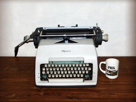 "Philip K. Dick's typewriter and favorite mug, his ""workstation."" Image via GavinRothery.com"