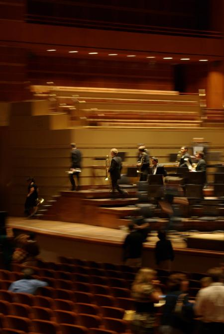 James Darrell and the trombones of the Duncanville Wind Ensemble leave the stage at the Morton H. Meyerson Symphony Hall