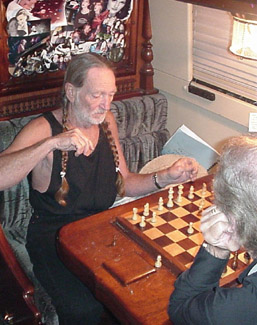 Willie Nelson playing chess on the band bus - Texas School of Music Collection