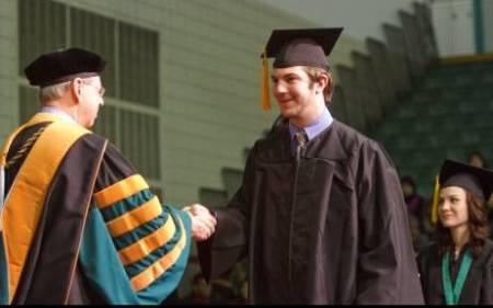UT-Dallas photo of 12-2009 graduation - Kenny Darrell pictured