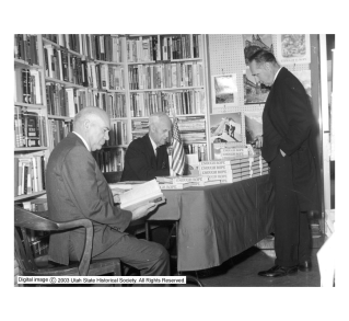 "Caption from the Utah Historical Society: Arthur Watkins (seated, center), a United States Senator from Utah, is shown here at a book signing for his book, ""Enough Rope"" at Sam Weller's Bookstore.""Enough Rope"" was a book about Joe McCarthy and the red scare. Rights management Digital Image (c) 2004 Utah State Historical Society. All Rights Reserved. (use here allowed by UHS, for education)"