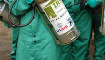 Tanks of pesticide (DDT?) used for Indoor Residual Spraying (IRS) against malaria in Africa bear the labels to indicate USAID paid for the tools and the pesticide, contrary to hoaxsters' claims.