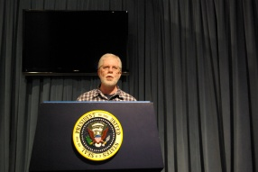 Ed Darrell at the Presidential Podium (mockup, at George H. W. Bush Library), 2011
