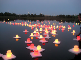 Hiroshima citizens float candles in the river, Hiroshima Day 2008