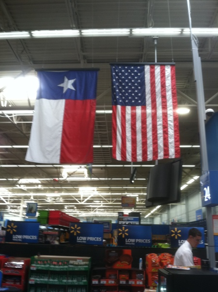 Texas and U.S. flags improperly displayed at the Wal-Mart across the street from Cowboys Stadium in Arlington, Texas. Flags are either backward, or upside down. Photo by Ed Darrell, from my iPhone. Any reuse of image requires proper attribution.