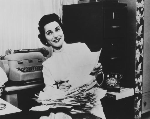 """Dear Abby,"" Abigail van Buren, sorts through letters asking advice. Newseum photograph, from publicity photo."