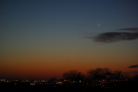 A view to the west over south Grand Prairie, Texas, showing the sliver of the new Moon, but a no-show Comet Pan-STARRS, March 12, 2013.  Photo by Ed, Kathryn and Peanut.