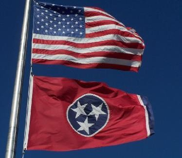 U.S. and Tennessee flags flying together on one staff. Photo by J. Stephen Conn