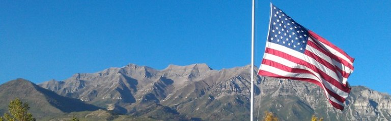 One of my favorite Utah photos: U.S. flag at the south end of Mount Timpanogos; photo from Orem, Utah, by Bob Walker.