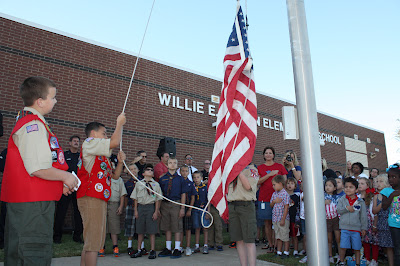 Boy Scouts and Girl Scouts raised the U.S. flag at Patriot Day ceremonies in 2012 at Willie Brown Elementary School, in Mansfield ISD, Mansfield, Texas.