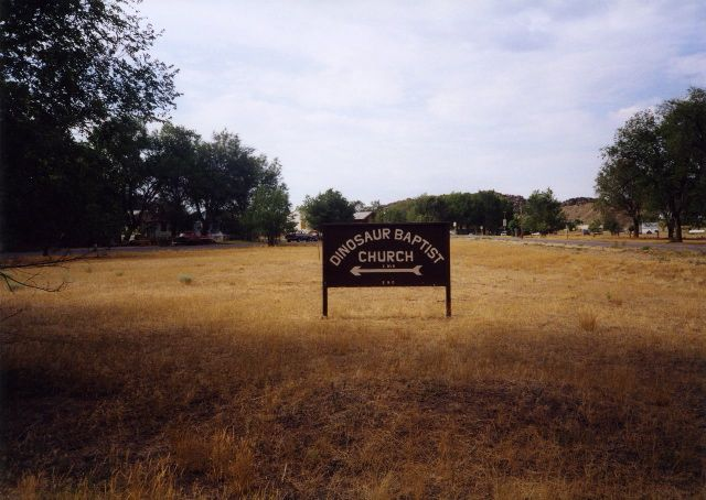 Another shot of the directional sign for Dinosaur Baptist Church, from earlier in 2011, I think.  From Text of the Day.