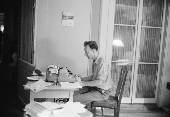 Pete Seeger at his typewriter, probably in the 1950s.