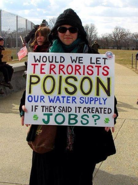 "Protester in West Virginia:  ""Would we let terrorists poison our water supply, if they said it created jobs?""  Photographer unidentified; so is protester."