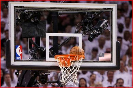 Ball stuck in Game 5 of NBA finals between Miami and Oklahoma City; note flag decal on right. AP photo