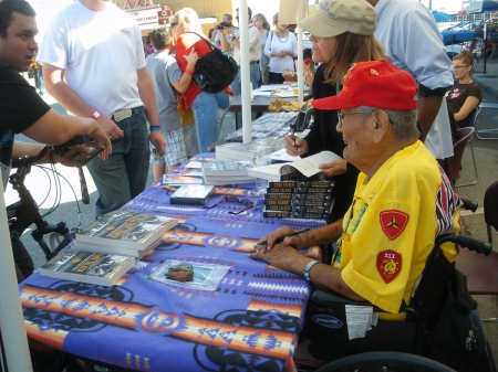 Navajo Code Talker, Marine Chester Nez, signing copies of his book, Code Talker, in Carrollton, Texas, October 14, 2012; photo by Ed Darrell