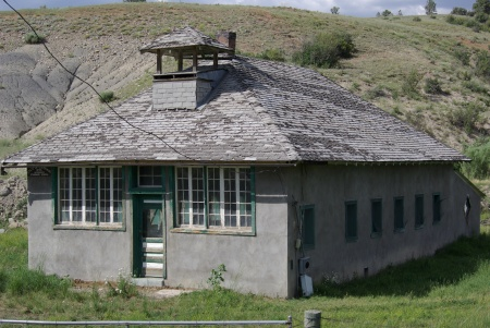 East of Durango, along U.S. Highway 160, a school building with a sign suggesting it was built in 1895.