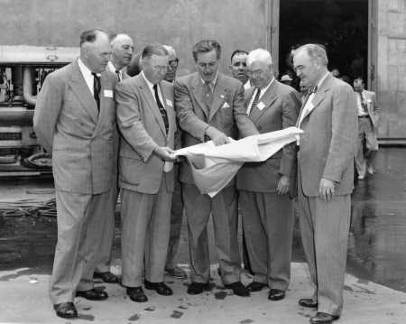 From the Orange County Archives: Walt Disney shows Disneyland plans to Orange County officials, Dec. 1954  The men in the front row (left to right) are Anaheim Mayor Charles Pearson, Orange County Supervisor Willis Warner, Walt Disney, Supervisor Willard Smith, and Orange County Planning Commission Chairman Dr. W. L. Bigham. The photo was taken at Disney Studios in Burbank. Photo from the Orange County Archives' Willard Smith Collection.