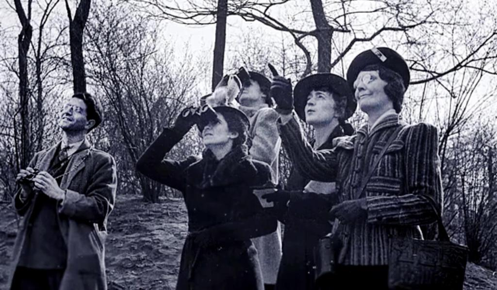"Still photo captured from the film, ""Christmas Bird Count,"" by Chan Robbins; photo shows a group counting birds, probably in the 1940s or 1950s. Audubon's Christmas Bird Count got its start in 1900."