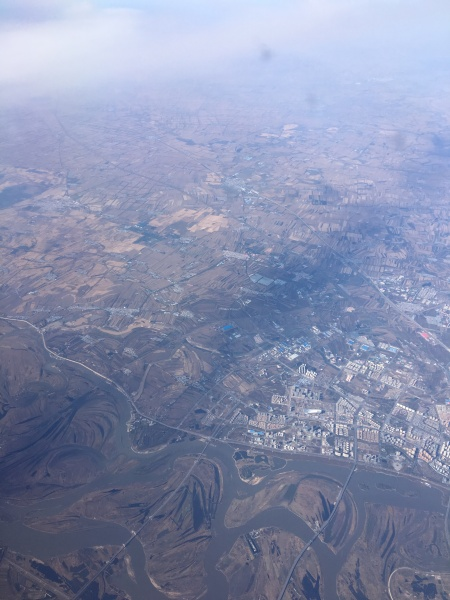 Semi-rural area north of Beijing, from 30,000 feet or so. Note new, high-rise apartment buildings in the small town. Photo by Ed Darrell