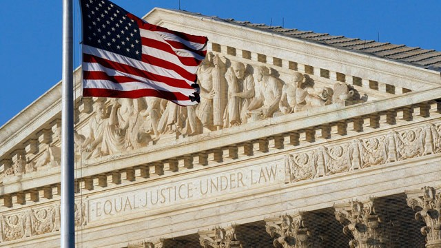 US flag flying at the U.S. Supreme Court's west portico, suitable for Law Day, May 1. (But this photo was taken in June, 2012; Alex Brandon/AP)