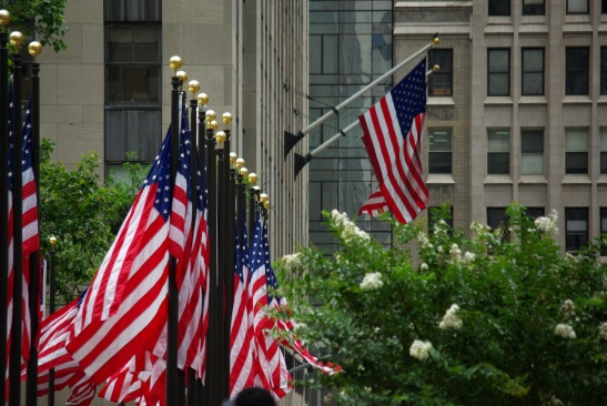 Flags fly in July at Rockefeller Center, New York City. Photo by Ed Darrell; please use, with attribution.