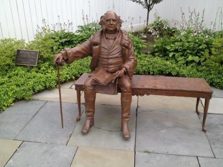 At Broad and Hudson Streets in Kinderhook, New York, one can sit with a statue of Martin Van Buren, and see if one can decipher the newspaper he is reading. PresidentsUSA image