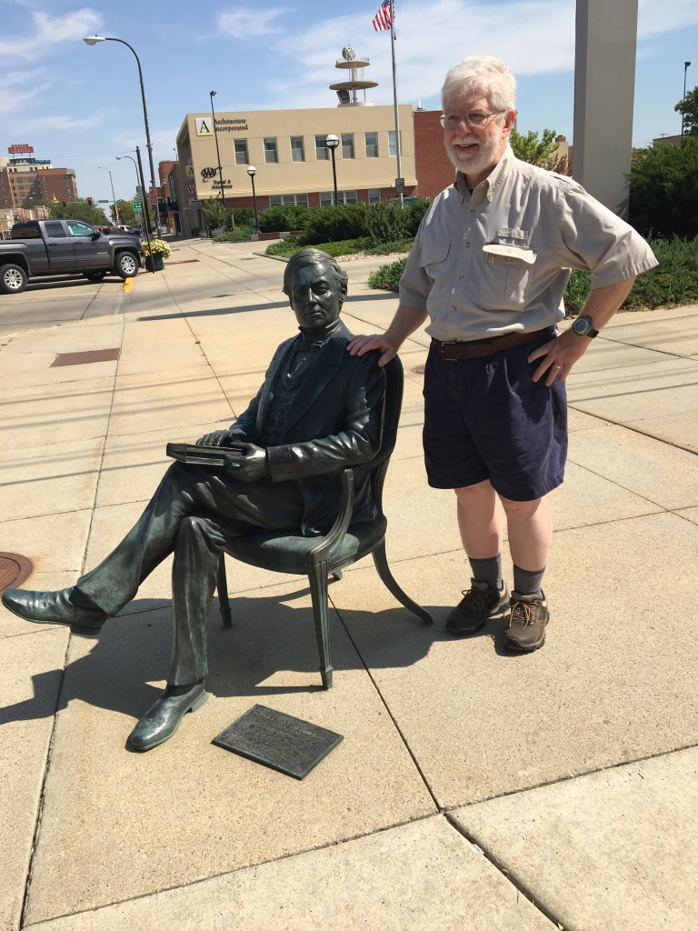 The author and a bronze likeness of Fillmore meet on a street in Rapid City, South Dakota, August 2016
