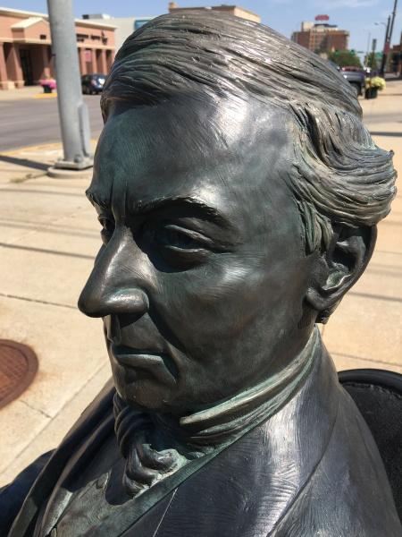 Millard Fillmore, bronzed, sitting at the corner of 9th and St. Joseph Streets in Rapid City, South Dakota. He still gets around. Photo by Ed Darrell. Please use.