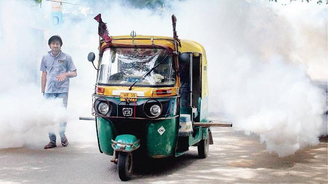 A small vehicle fogging streets of Delhi, India, with DDT, to fight mosquitoes. File photo from India Today, used to illustrate the story only.