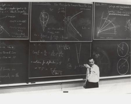 "Feynman lecturing, with six chalkboards full of equations, diagrams and notes. CalTech? Feynman would have been 100 years old on May 11, 2018. This became the ""lost lecture,"" now found."