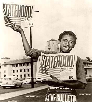 13-year-old paperboy Chester Kahapea happily hawks a commemorative edition of the Honolulu Star-Bulletin with the headline showing the state had achieved statehood after the U.S. House of Representatives passed the law authorizing Hawaii as a state. Star-Bulletin photo by Murray Befeler