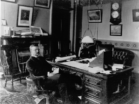 Theodore Roosevelt in his office as Assistant Secretary of the Navy. DOD image.