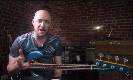 Scott Devine and a blue Fender Bass. Scott's the guy behind the YouTube monster, Scott's Bass Lessons.